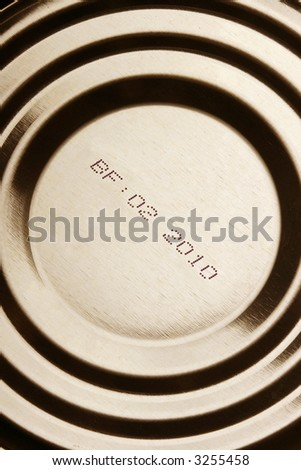Close-up of canned food with expiration date