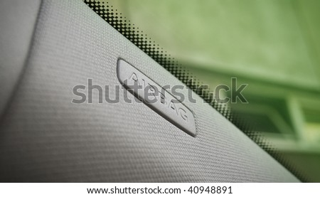 close up of car interior showing a side airbag location.
