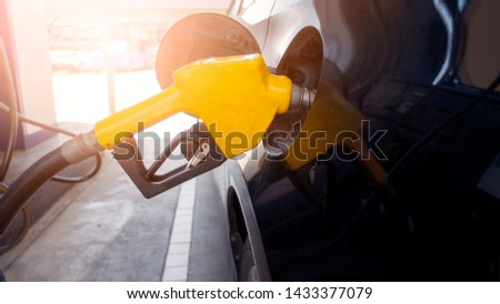 Close up of car is refilling oil fuel in Gas Station  #1433377079