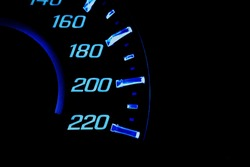close up of car meter with black background