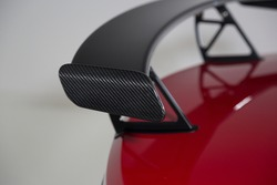 Close up of carbon fiber spoiler on a red sports car