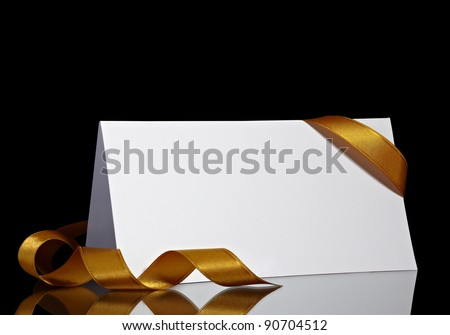 close up of  card note with  ribbon on black background