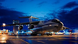 Close up of cargo airliner in the night