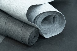 Close up of carpet rolls. Polyester or felt carpets background