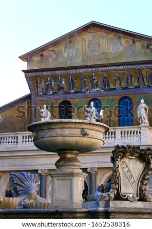 Close up of catholic church called santa maria in trastevere, in Rome, Italy. Fountain in the foreground and statues and paintings in the backgriund