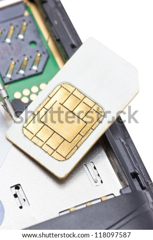 Close up of cell phone and sim card.
