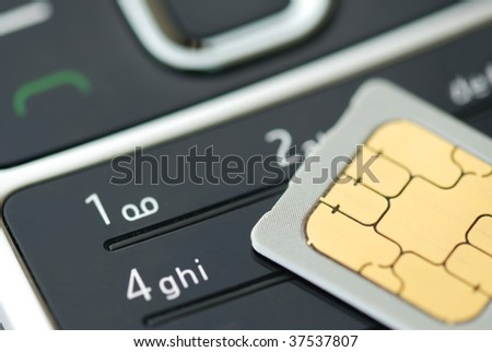 Close up of cell phone and sim card