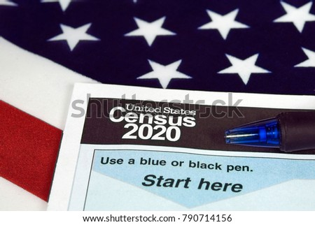 close up of 2020 census document form and ballpoint pen on American flag Stockfoto ©