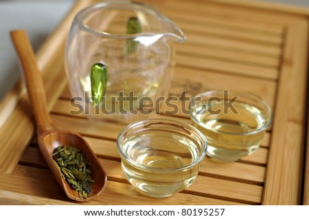 Close up of ceremonial tea set on wooden board