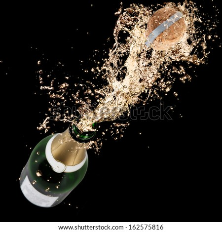 Close-up of champagne explosion. Celebration theme. #162575816