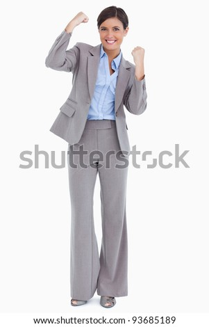 Close up of cheering female entrepreneur against a white background
