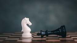 Close-Up Of Chess Pieces white knight Against dark background, International chess, ideas and competition and strategy, chess board game competition business concept