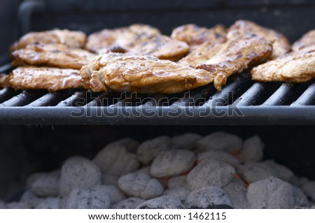 close up of chicken on grill
