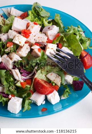 Close up of chicken salad with feta, lettuce and tomatoes