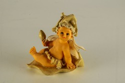 Close-up of child angel statuette Object on a White Background