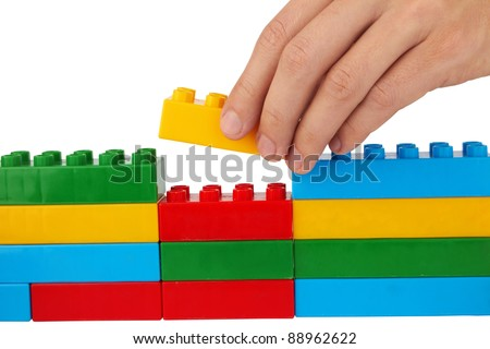 close up of child toy bricks construction isolated on white background