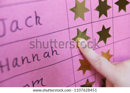Close Up Of Child With Reward Chart