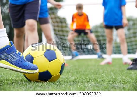Close Up Of Children\'s Feet In Soccer Match