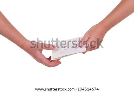 Close-up of childrens hands passing a note
