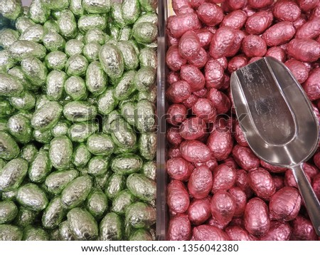 Close up of chocolate easter or pachal eggs and scoop. Beautiful colors, pink and green, background picture.Typical dutch tradition. Gift on the occasion of Easter. Stockfoto ©