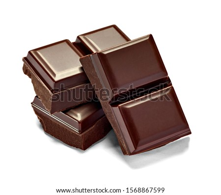 close up of chocolate pieces on white background