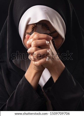 Close up of Christian, Catholic nun's holding rosary ,cross, in the praying hands. Prays in silence with faith and devotion. Religion concept. #1509709706