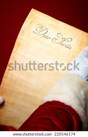 Close-up of Christmas letter held by Santa Claus