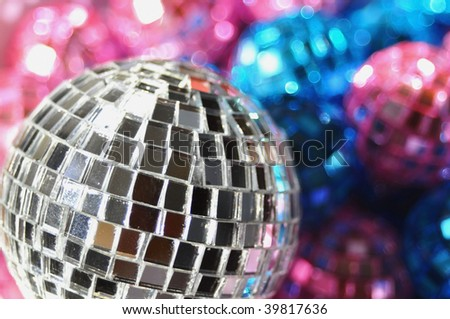 "close up of christmas ornaments focus on silver ""disco"" ball - stock photo"