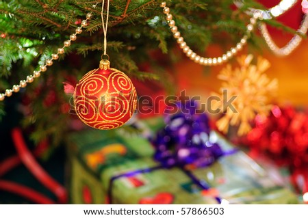 Close up of christmas tree with gifts.