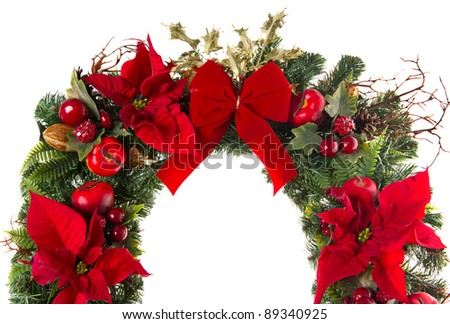 close-up of christmas wreath with poinsettia flowers