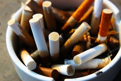 Close up of cigarette fag ends in the ashtray