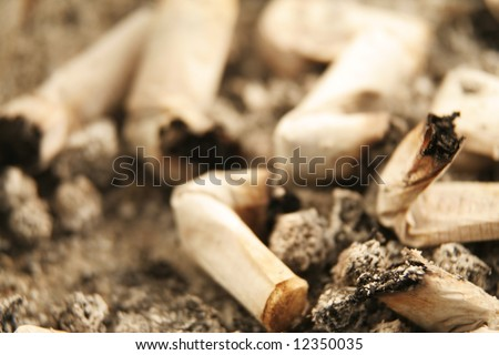 Close up of cigarettes in an ashtray (low DOF)