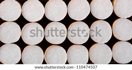 Close-up of cigarettes in pack. Background or texture