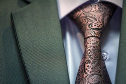 Close up of classic business attire with tie and elegant blazer.