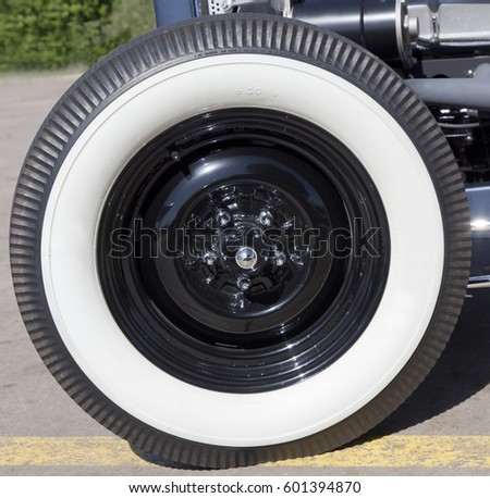 detail close up of classic white sidewall tire