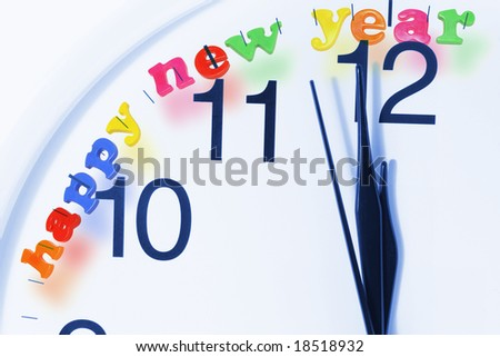Close-up of Clock Face with Happy New Year