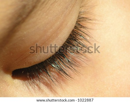 Close-up of closed eye of at child