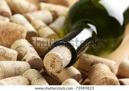 Close-up of closed wine bottle and heap of used. - stock photo