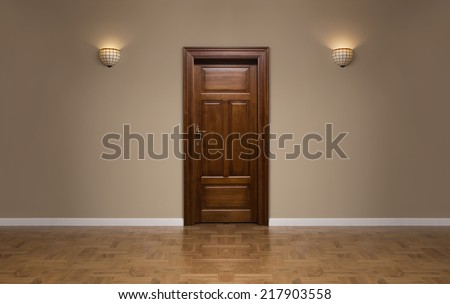 Close up of closed wooden door in the empty room with copy space #217903558