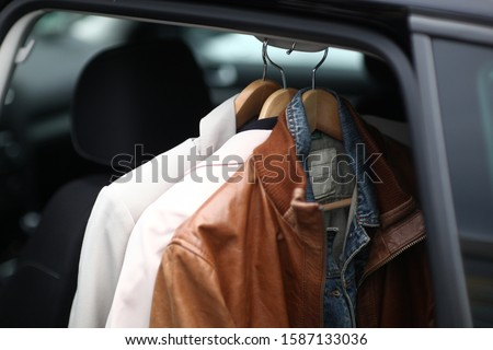 Close up of clothing on coat hanger in car, Munich, Bavaria, Germany, Europe