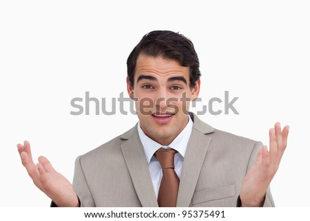 Close up of clueless salesman against a white background