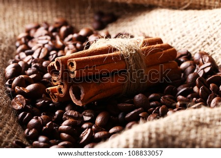 Close up of coffee beans and cinnamon sticks