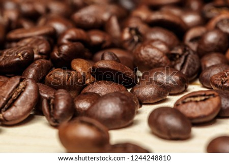 Close up of coffee beans on a wooden background #1244248810