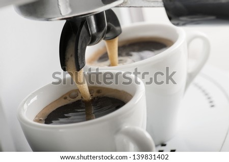 close up of coffee machine makes two coffee