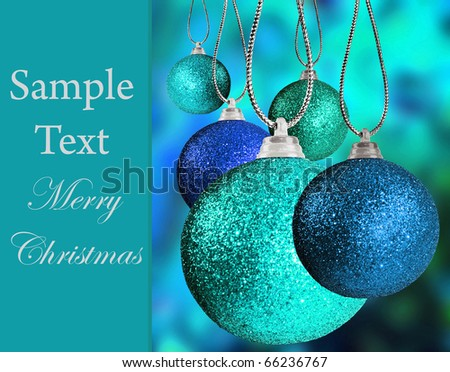 Close up of colorful blue christmas bauble balls in different sizes  hanging on strings