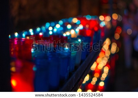 Close up of colorful candles in a dark spiritual scene. Commemoration, funeral, memorial. Religious symbolism. #1435524584