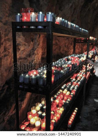 Close up of colorful candles in a dark spiritual scene. Commemoration, funeral, memorial. Religious symbolism. #1447240901
