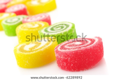 Close-up of colorful candy on white background.