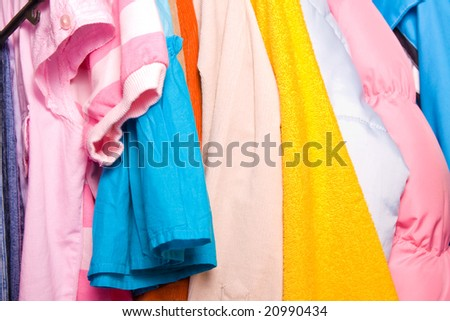 Close up of colorful child clothes in closet