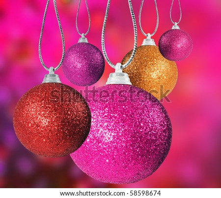 Close up of colorful christmas bauble balls in different sizes  hanging on strings